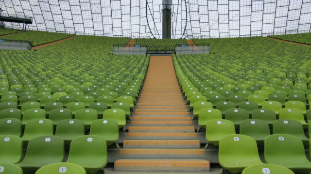 ms la shot of seating chairs and staircase of olympic stadium munich / munich, bavaria, germany - chairs in a row stock videos & royalty-free footage