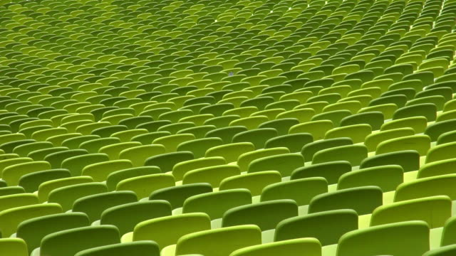 ms shot of seating chairs of olympic stadium munich / munich, bavaria, germany - sitz stock-videos und b-roll-filmmaterial