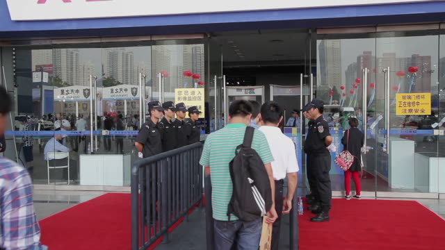 MS Shot of Security staff of exhibition entrance / Xi'an, shaanxi, China