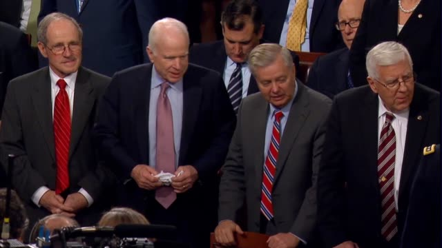 shot of senators jim risch, lindsey graham, john mccain and mike enzi, and a boom shot of the house chamber before president donald trump arrives for... - john mccain stock videos & royalty-free footage