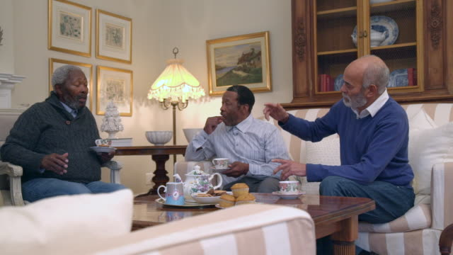 MS PAN Shot of senior African and mixed race men drinking tea / Cape Town, Western Cape, South Africa