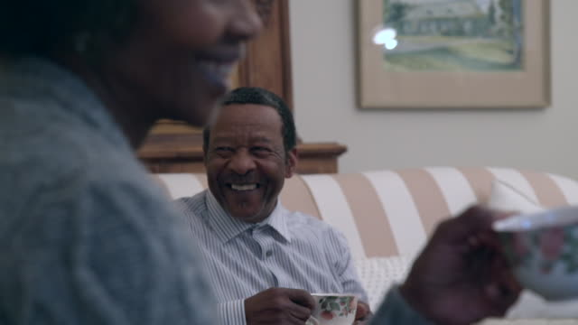 cu r/f shot of senior african man and woman drinking tea / cape town, western cape, south africa - drinking tea stock videos and b-roll footage