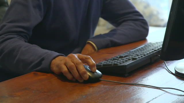 CU Shot of Senior mixed race man using personal computer / Cape Town, Western Cape, South Africa