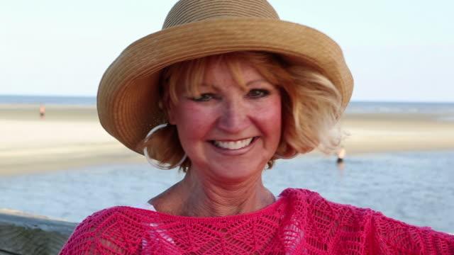 MS PAN Shot of Senior woman at beach / St. Simon's Island, Georgia, United States