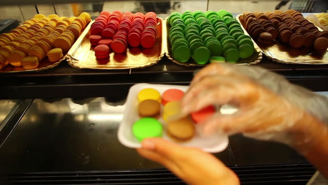 ms shot of serving macaroons / belo horizonte, minas gerais, brazil - macaroon stock videos and b-roll footage