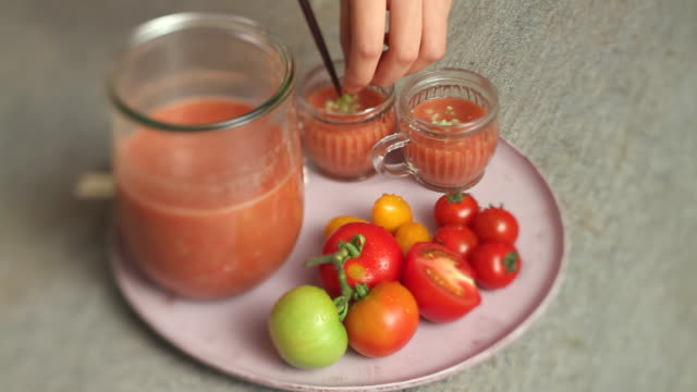 cu shot of setting garnish on vegetable juice / seoul, south korea - tomato juice stock videos and b-roll footage