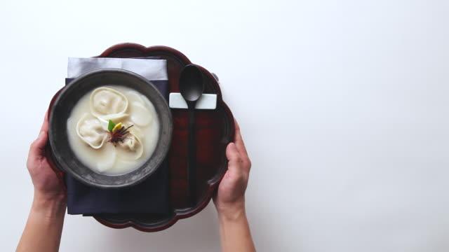 CU Shot of setting table with rice cake soup (Korea's traditional soup) / Seoul, South Korea