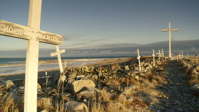 ws shot of several grave site crossing line of street / arviat, nunavut, canada - wiese stock videos & royalty-free footage