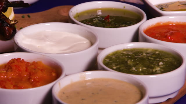 shot of several small bowls of different sauces - dipping stock videos & royalty-free footage
