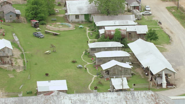 ms aerial shot of shack up inn sharecropper shacks with landscape / clarksdale, mississippi, united states - sharecropper stock videos & royalty-free footage