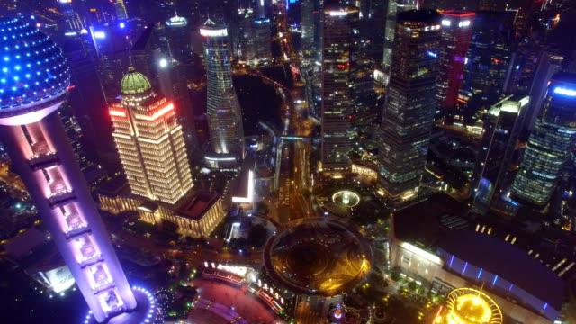 aerial shot of shanghai cityscape and skyline at night/shanghai,china - schanghai stock-videos und b-roll-filmmaterial