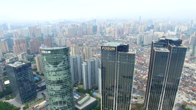 aerial shot of shanghai cityscape and skyline /shanghai,china - shanghai world financial center stock videos & royalty-free footage