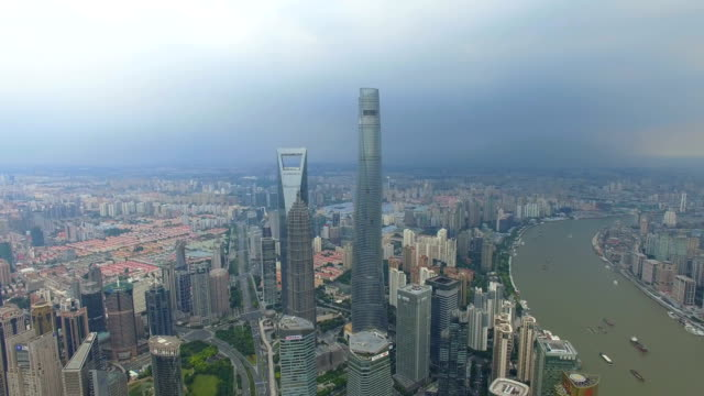 aerial shot of shanghai cityscape and skyline/shanghai,china - 上海環球金融中心点の映像素材/bロール