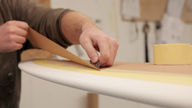 stockvideo's en b-roll-footage met cu shot of shaper masking up surfboard before glassing / wadebridge, cornwall, united kingdom - surfboard