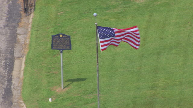 CU AERIAL TS ZO Shot of Shelby's Last Stand marker and United States flag and Forest Hill Cemetery / Kansas City, Missouri, United States