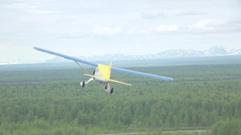 ms aerial ts shot of sheldon air beaver en route to denali flying over forests / alaska, united states - air to air shot stock videos & royalty-free footage