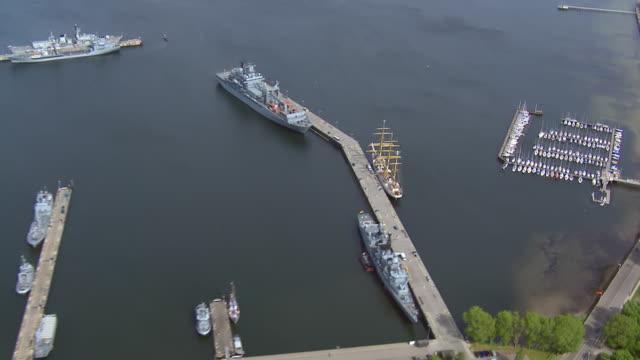 ms aerial zo shot of ship and sailboat on sea / kiel, schleswig holstein - schleswig holstein stock-videos und b-roll-filmmaterial