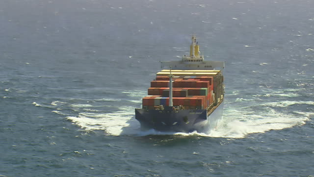 MS AERIAL DS Shot of Ship in running on sea surface / Alderney, Channel Isles