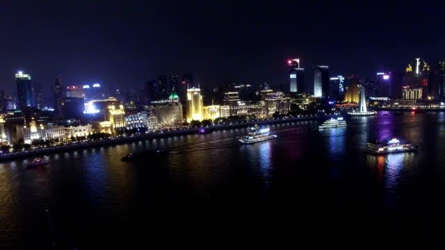 aerial shot of ship running on huangpu river at night/shanghai,china - river huangpu stock videos & royalty-free footage
