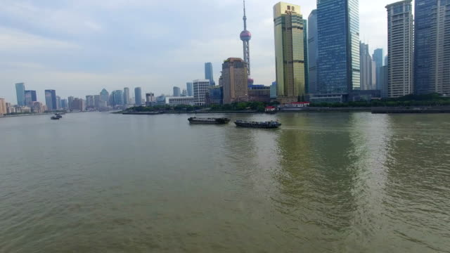 aerial shot of ship running on huangpu river/shanghai,china - river huangpu stock videos & royalty-free footage