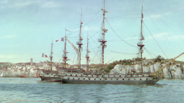 WS Shot of ships in harbor, in background along with some land and houses