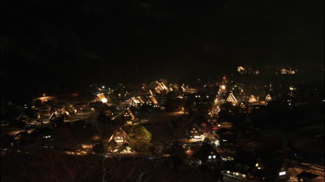 ws t/l shot of shirakawago at night / gifu, japan - dorf stock-videos und b-roll-filmmaterial