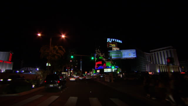 ms pov pan shot of shop sign and building lights illuminated in city at night / las vegars, united states - shop sign stock videos & royalty-free footage