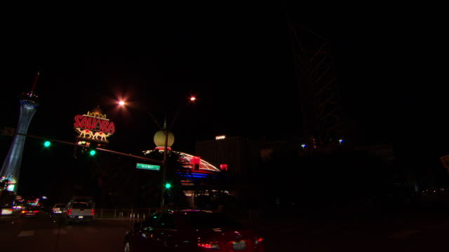 ms pov shot of shop sign and building lights illuminated in city at night / las vegars, united states - shop sign stock videos & royalty-free footage