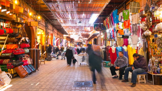"""MS T/L ZI Shot of shops at Marrakesh market """"souq as Smarrine"""" with people moving / Marrakech, Morocco"""