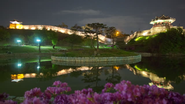 ms t/l shot of shot of suwon hwaseong castles at night (unesco heritage) / suwon, gyeonggi-do, south korea - suwon stock videos and b-roll footage