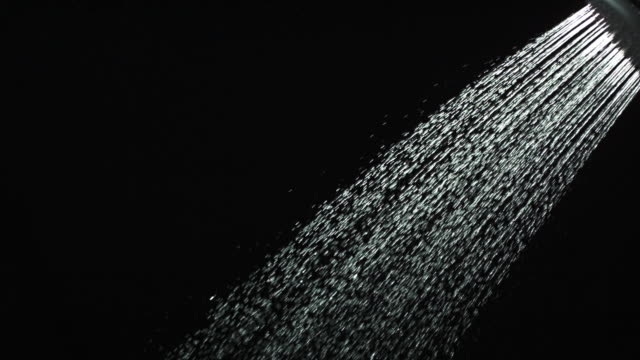 vídeos y material grabado en eventos de stock de ms slo mo shot of shower spraying water out / united kingdom - alcachofa de la ducha