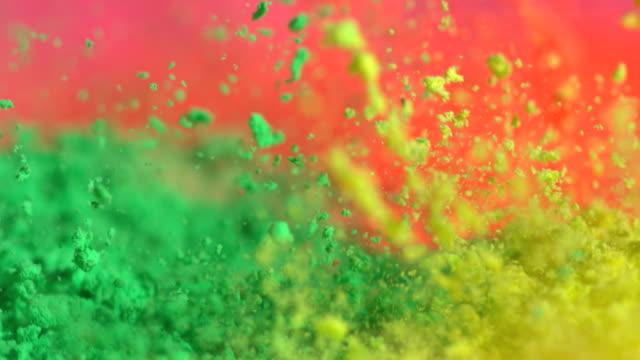 ecu slo mo shot of showing multiple holi color splashing up / munich, bavaria, germany - powder paint stock videos & royalty-free footage
