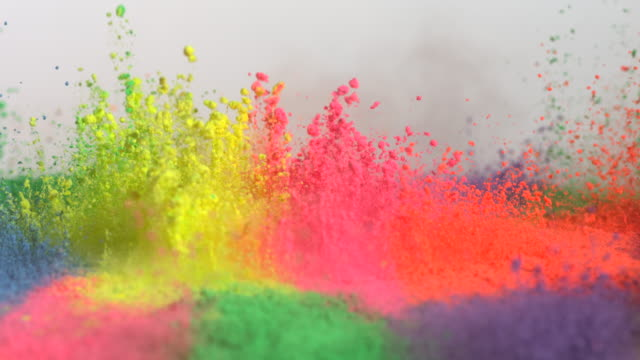 cu slo mo shot of showing multiple holi colors splashing up / munich, bavaria, germany - カラフル点の映像素材/bロール
