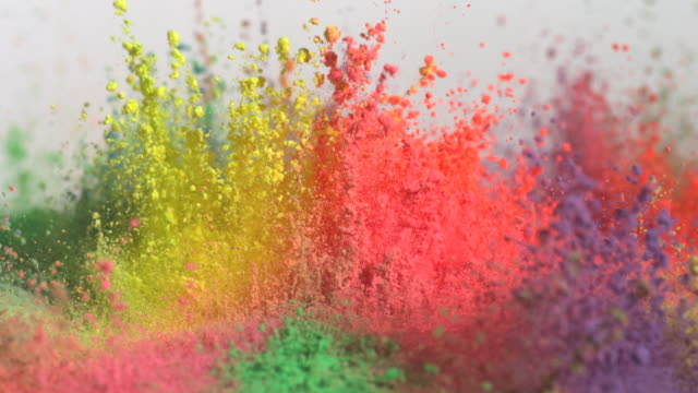 cu slo mo shot of showing multiple holi colors splashing up / munich, bavaria, germany - colori video stock e b–roll