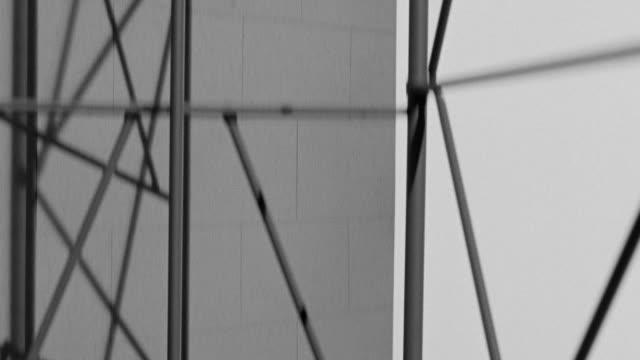 ms pov shot of side of miniature building under construction, steel girdered floors no ropes - fahrstuhlperspektive stock-videos und b-roll-filmmaterial