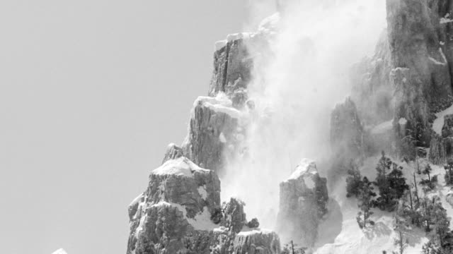 ms shot of side of snow covering mountain, avalanche occurs - avalanche stock videos and b-roll footage