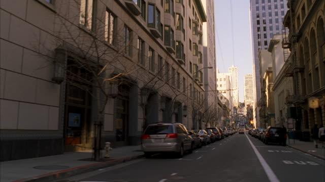 stockvideo's en b-roll-footage met ms pov shot of sidewalk in front of shopping center buildings in city / san francisco, california, united states   - straatnaambord