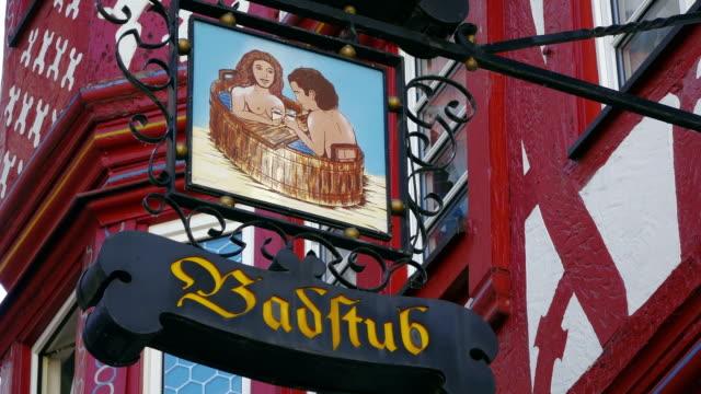 cu la shot of sign badstub at market square / bernkastel kues, rhineland palatinate, germany - female likeness stock videos & royalty-free footage