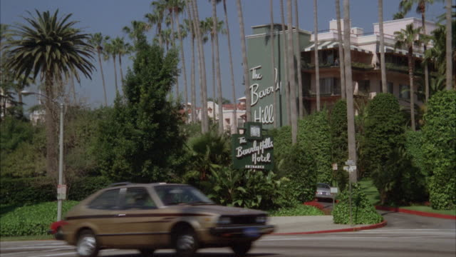 ms zi shot of sign boar of beverly hills hotel - 1980 stock videos & royalty-free footage