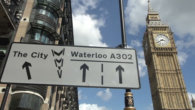 ms shot of sign board in fron of big ben / london, united kingdom - direction stock videos & royalty-free footage