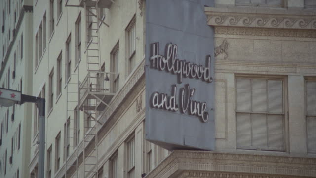 ms td shot of sign hollywood and vine on board - 1978 stock videos and b-roll footage
