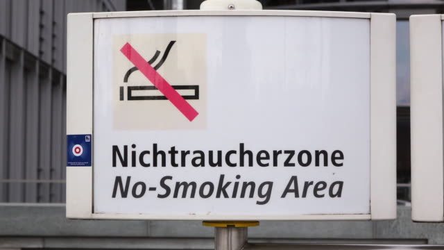 cu shot of sign no smoking area at subway station / berlin, germany - western script stock videos & royalty-free footage