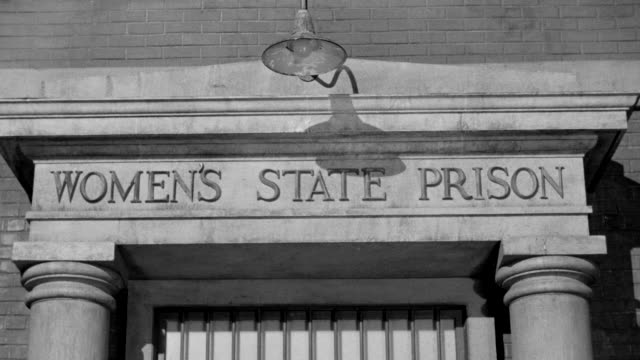 ms shot of sign over entrance to women's state prison - western script stock videos & royalty-free footage