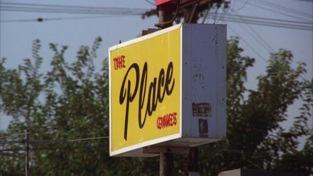 """vídeos y material grabado en eventos de stock de ms shot of sign """"the place bar"""" - letrero de tienda"""