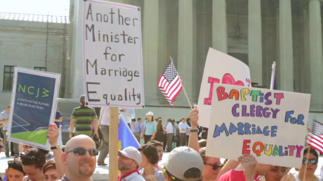 CU ZO Shot of Signs in favor of marriage equality during rally in front of Supreme Court building / Washington, District of Columbia, United States