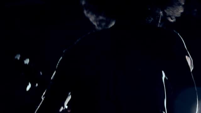 ms shot of silhouette of young man playing bass guitar / shinjuku, tokyo, japan - bass guitar stock videos & royalty-free footage