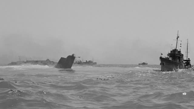 WS Shot of sinking ship in water shells and planes falling from sky