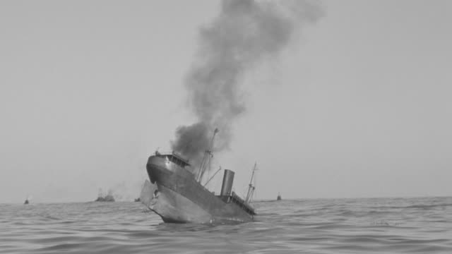 ms shot of sinking ships with battle ships are under attack in ocean  - militärschiff stock-videos und b-roll-filmmaterial