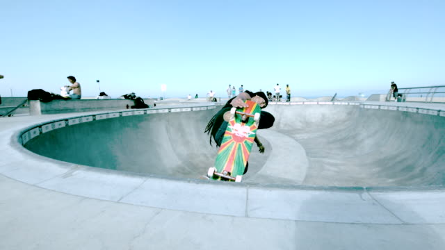ws slo mo shot of skateboarder doing aerial tricks in skate park bowl / venice, california, united states - skateboard stock videos and b-roll footage
