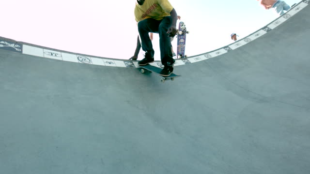 WS SLO MO LA Shot of skateboarders dropping in / Venice, California, United States